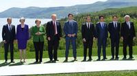 Donald Tusk, Theresa May, Angela Merkel, Donald Trump, Justin Trudeau, Emmanuel Macron, Shinzo Abe, Giuseppe Conte et Jean-Claude Juncker lors du sommet du G7 en juin 2018 à La Malbaie, au Canada.