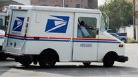 Un camion de la Poste américaine [Kevork Djansezian / Getty Images/AFP/Archives]