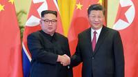 Kim Jong-un s'est rendu quatre fois en Chine l'an dernier pour rencontrer Xi Jinping. Ici, en juin 2018, à Pékin.