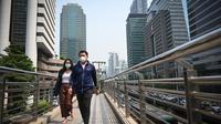 Les habitants utilisent des masques pour se protéger de la pollution à Bangkok
