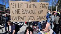 Une pancarte lors de la Marche du siècle en faveur de l'environnement, le 16 mars.