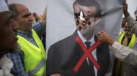 Le portrait d'Emmanuel Macron a été brulé par des manifestants en Lybie en avril 2019.