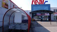 Un supermarché Real [Patrik Stollarz / AFP/Archives]