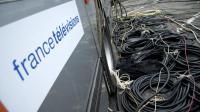 Des câbles devant un camion technique de France Télévisions [Nathalie Magniez / AFP/Archives]