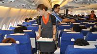 Une hôtesse de l'air transsexuelle sur un vol de la compagnie thaïlandaise PC Air, le 9 mars 2012 [Amelie Bottollier-Depois / AFP/Archives]