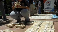 Le Brésil pâtit d'un effet collatéral de la bonne santé de son économie : un boom de la consommation de cocaïne et dérivés qui a conduit les autorités à renforcer la surveillance de ses frontières avec la Bolivie, le Pérou et la Colombie, principaux producteurs mondiaux de poudre blanche.[AFP]