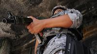 Un policier brésilien dans une favela de Rio, le 18 mai 2012 [Vanderlei Almeida / AFP/Archives]