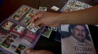 Un album de vignettes autocollantes consacré à de célèbres tueurs et narco-trafiquants colombiens rencontre depuis quelques jours un fort succès dans les quartiers déshérités de Medellin, ville du nord-ouest de la Colombie où a prospéré le baron de la drogue Pablo Escobar.[AFP]