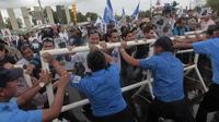 Des Nicaragayens protestent contre la concession accordée à un avocat pour la création d'un canal entre l'Atlantique et le Pacifique, le 13 juin 2013 à Managua [Inti Ocon / AFP]