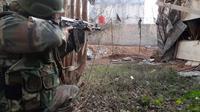 Un soldat syrien à Daraya, au sud-ouest de Damas, à une date inconnue [- / Sana/AFP/Archives]