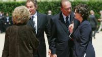Jacques Chirac et son épouse Bernadette accueillent Tony Blair et son épouse Cherie, le 6 juin 2004 à Caen [Patrick Kovarik / AFP/Pool/Archives]