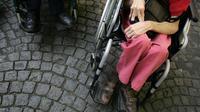 Des personnes handicapées en fauteuil roulant [Olivier Laban-Mattei / AFP/Archives]