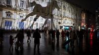 L'ombre d'un cheval est projetée sur une façade d'immeuble à Lyon dans le cadre de la Fête des Lumières, le 7 décembre 2011 [Jean-Philippe Ksiazek / AFP/Archives]