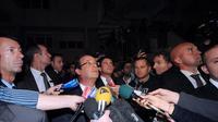 François Hollande interpellé depuis son appartement par un habitant d'Echirolles, en banlieue de Grenoble, le 1er octobre 2012 [Jean-Pierre Clatot / AFP/Archives]
