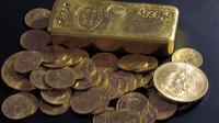 Un lingot et des pièces d'or [Bertrand Guay / AFP]