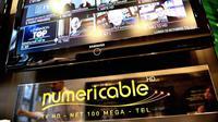 Mosaïque des chaînes télé diffusées par Numericable, sur un écran dans un magasin à Lille, en octobre 2012 [Philippe Huguen / AFP/Archives]