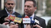 Le ministre grec des Finances Yannis Stournaras répond aux journalistes après une réunion avec le président Carolos Papoulias, le 5 décembre 2012 à Athènes [Louisa Gouliamaki / AFP]