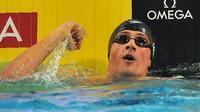 Le nageur américain Ryan Lochte jubile après avoir battu le record du monde du 100 m 4 nages, en demi-finales des Mondiaux en petit bassin, le 15 décembre à Istanbul. [Mira / AFP]