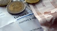 Une facture d'éléctricité et des euros