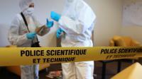 Des agents de la police scientifique lors d'un exercice, en janvier 2013 près de Paris [Thomas Samson / AFP/Archives]