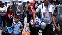 Des familles fuient le nord de l'Irak à l'arrivée des jihadistes de l'EIIL