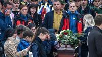 Cérémonie funéraire pour les victimes de la fusillade dans un lycée à Kertch en Crimée, le 19 octobre 2018 [Andrey PETRENKO / AFP]