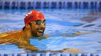Le nageur américain Michael Phelps à l'entraînement lors du Grand Prix de Charlotte le 15 mai 2014 à Charlotte, Etats-Unis [Streeter Lecka / AFP]