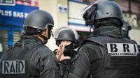 Des membres du RAID et de la BRI lors de l'assaut à Saint-Denis le 18 novembre 2015 après les attentats de Paris le 13 novembre 2015 sur une photo diffusée par le ministère de l'Intérieur le 20 novembre 2015 [Francis Pellier / MINISTERE DE L'INTERIEUR/AFP/Archives]