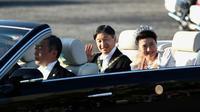 L'empereur Naruhito et l'impératrice Masako durant leur parade publique le 10 novembre 2019 à Tokyo [Behrouz MEHRI / AFP]