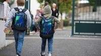 Selon plusieurs enquêtes, le harcèlement toucherait en primaire 12% des élèves, dont 5% de manière sévère, 10% au collège (7% de manière sévère), et 1,4% des lycéens. [Thierry Zoccolan / AFP/Archives]