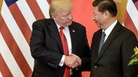 Le président américain Donald Trump et son homologue chinois Xi Jingping à Pékin le 9 novembre 2017 [Fred DUFOUR / AFP/Archives]