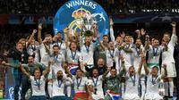 Les joueurs du Real Madrid avec le trophée de la Ligue des champions remportée le 26 mai 2018 à Kiev face à Liverpool [LLUIS GENE                           / AFP/Archives]