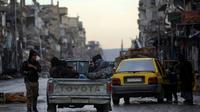 Les forces de sécurité à Raqa annoncent un couvre-feu de deux jours à partir de dimanche pour prévenir d'éventuelles attaques du groupe Etat islamique (EI) dans cette ville du nord de la Syrie [DELIL SOULEIMAN / AFP/Archives]