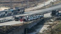 Véhicules de la Croix Rouge internationale et du Croissant Rouge Syrien à un point de passage le 18 décembre 2016 à Ramoussa dans la banlieue sud d'Alep [George OURFALIAN / AFP]