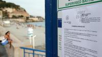 Un arrêté municipal interdisant le port du burkini sur une plage de Nice, le 19 août 2016 [JEAN CHRISTOPHE MAGNENET / AFP/Archives]