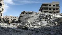 Photo de destructions dans la ville tenue par les rebelles de Saqba, dans la Ghouta orientale, cible de bombardements meurtriers du régime syrien, le 9 mars 2018 [ABDULMONAM EASSA / AFP]