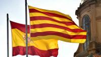 les drapeaux espagnol et catalan devant le siège du gouvernement régional le 26 septembre 2015 à Barcelone [GERARD JULIEN / AFP]