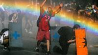Affrontements au Chili entre manifestants antigouvernementaux commémorant la mort d'un jeune Indien mapuche tué par la police un an auparavant et policiers anti-émeutes, à Santiago le 14 novembre 2019 [JAVIER TORRES / AFP]