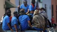 Les forces paramilitaires loyales au président Ortega patrouillent dans les rues de Masaya au Nicaragua, reprise la veille aux rebelles, le 18 juillet 2018 [MARVIN RECINOS / AFP]
