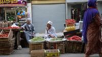 Des vendeurs des rues au Caire, le 26 août 2013 [Marwan Naamani / AFP/Archives]