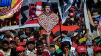 Les membres de la milice bolivarienne du Venezuela et les militants pro-gouvernement manifestent leur soutien au président Nicolas Maduro lors d'un rassemblement devant le palais présidentiel à Caracas, le 6 août 2018 [Federico PARRA / AFP]