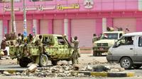 Des forces de sécurité soudanaises postées dans un rue de la capitale Khartoum, le 9 juin 2019 [- / AFP]