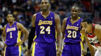Kobe Bryant (N.24) et Jodie Meeks (N.20) lors de la victoire des Los Angeles Lakers contre les Wizards à Washington, le 14 décembre 2012 [Rob Carr / Getty Images/AFP]