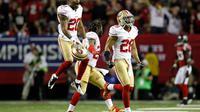 Perrish Cox (g), Anthony Dixon (c) et Darcel McBath fêtent la victoire des 49ers de San Francisco en finale de conférence de NFL, le 20 janvier 2013 à Atlanta [Chris Graythen / Getty Images/AFP]