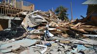 Les restes d'une maison dans la localité de Mexico Beach, en Floride, le 12 octobre 2018 [HECTOR RETAMAL / AFP]