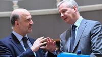 Le ministre français de l'Economie, Bruno Le Maire (d) , et le commissaire européen aux Affaires économiques, Pierre Moscovici (g), le 13 mars 2018 à Bruxelles [EMMANUEL DUNAND / AFP]