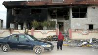 Photo d'un siège d'un parti politique au Kurdistan irakien incendié lors de manifestations, à Piramagroun, dans la province de Souleimaniyeh, le 19 décembre 2017 [SHWAN MOHAMMED / AFP]
