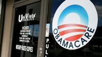 Le logo Obamacare sur la vitrine d'une agence d'assurance santé, le 10 janvier 2017 à Miami, en Floride [ / AFP/Archives]