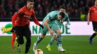 Le meneur de jeu du Stade Rennais Hatem Ben Arfa contre Arsenal en 8es de finale aller de l'Europa Ligue, le 7 mars 2019 à Rennes [DAMIEN MEYER / AFP]