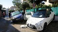 Des voitures endommagées pendant les inondations à Cannes, le 4 octobre 2015 dans le sud-est de la France [PatricK CLEMENTE / AFP]